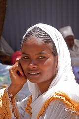 Portrait of a girl at Hosanna festival in Aksum - Ethiopia (NeSlaB .) Tags: world portrait woman festival canon easter religious photo women dress faith religion folklore holy christianity ethiopia rite maryam pilgrim axum rites developingcountries reportage pilgrims palmsunday hosanna etiopia aksum  thirld hossana feastofmary stmaryzion hosannafestival neslab  maryamfeast