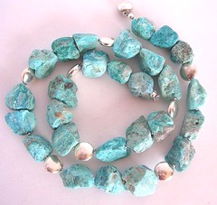 Raw nuggets of chrysocolla make a modern statement with a tribal twist