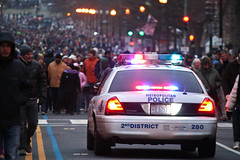 police car and crowds