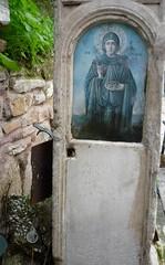 The Saint and the Condom (alison will) Tags: shrine condoms athens litter greece pollution disrespect aghiaparaskevi outdoorsex metaphorsforhowdegradedathenshasbecome