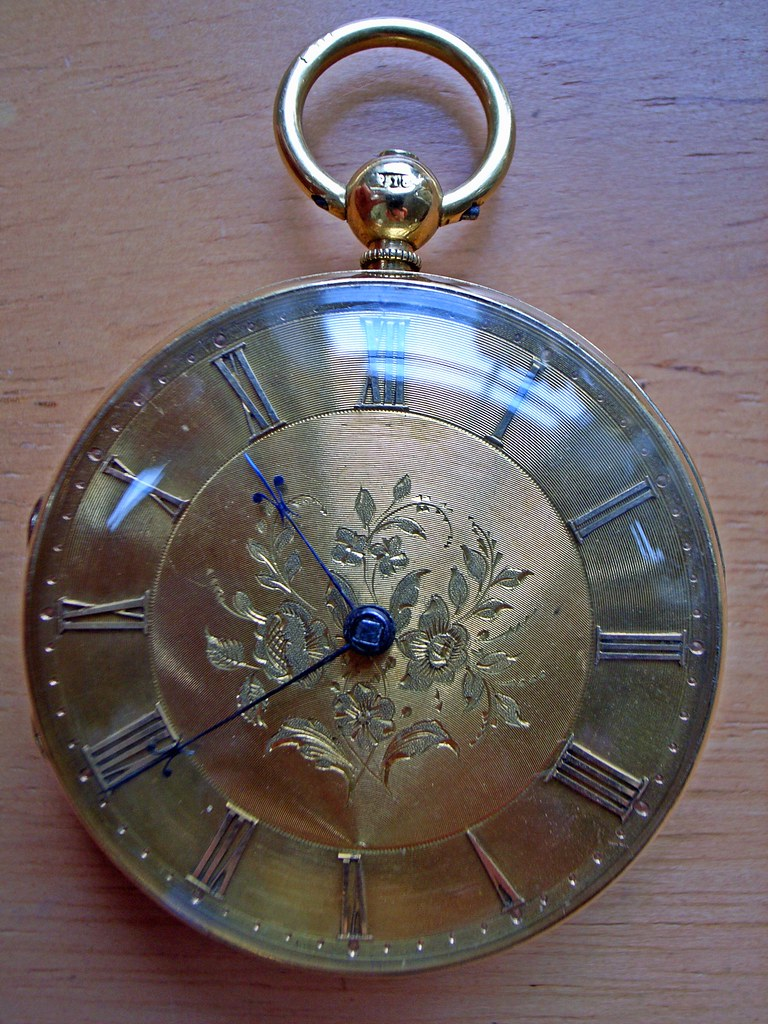 Pocket watch with gold dial