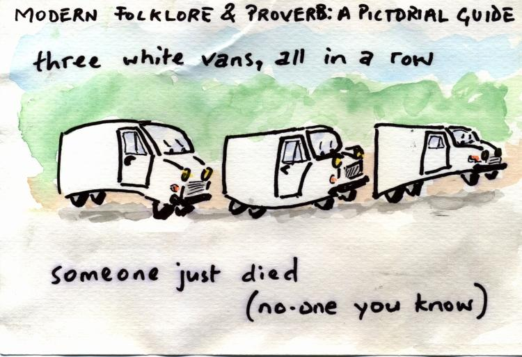 three white vans in a row
