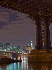 A Bridge Under a Bridge (TomBrooklyn) Tags: nyc longexposure bridge ny brooklyn night wow nice manhattan awesome great dumbo estuary financialdistrict brooklynbridge manhattanbridge eastriver usflag woolworthbldg abigfave tombrooklyn