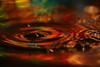 Water drop art - Aurora borealis in a bowl (Mukumbura) Tags: macro water reflections drops multicoloured auroraborealis birthdayballoon waterdropmacro canonef100mmf28macrousm the4elements