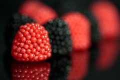very berry:  241/365 (helen sotiriadis) Tags: red food black macro reflection closeup fruit canon berry dof candy bokeh depthoffield 365 licorice haribo canonef100mmf28macrousm canoneos40d toomanytribbles