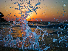 Splash Damage (erroltookaphoto) Tags: ocean camera sunset sun water turkey landscape waves dusk casio explore splash compact frozenintime exz70