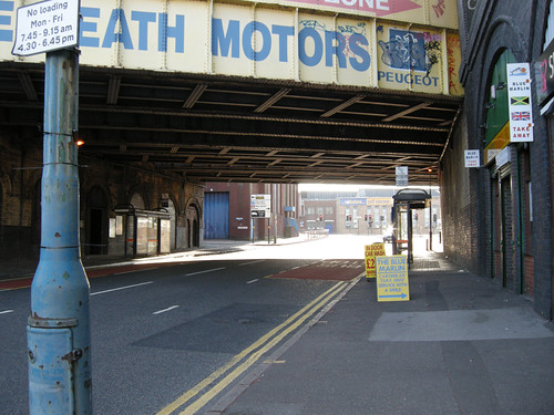 Shops and bus stops under the railway lines