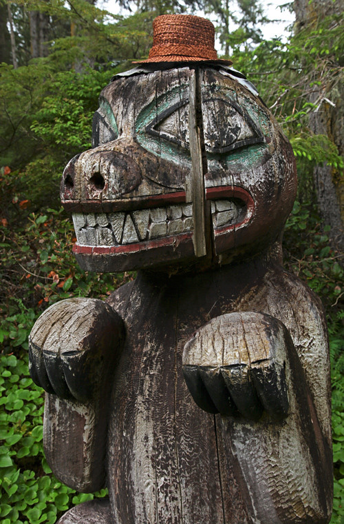bear memorial totem with cedar hat, Totems Historic District, Kasaan, Alaska