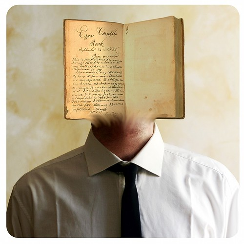 A photoshopped image of a man with his head replaced by an open book.
