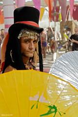 Shaman Randal (naturalturn) Tags: 2005 portrait usa man hat umbrella costume nevada tribal burningman blackrockcity parasol randal gypsy burningman2005 furtographer coinbelt shamanrandal randalalansmith image:rating=4 image:id=024454