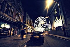 (andrewlee1967) Tags: bigwheel manchester night road street man streetlamp buildings city canon400d sigma1020mm andrewlee1967 uk gb britain england ferriswheel manchesterwheel urban dark yellowlines noparking audi walls doorways andrewlee