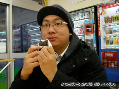 Street vagabond eating an onigiri
