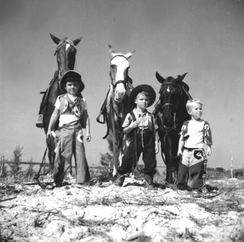 Three boys dressed as a cowboys with their horses: Saint Petersburg, Florida