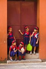 Waiting for school to start (bag_lady) Tags: school girls kerala schoolchildren cochin schooluniform southindia bluelist justpeople earthasia