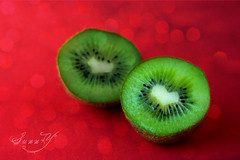 ~Kiwis are a good source of vitamin C... and love~ (Pink Pixel Photography (f.k.a. Sunny)) Tags: red heart bokeh canonef50mmf18 kiwi texturized canoneos400d eatmorefruit lalalalove scarletsunday