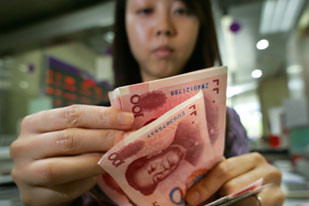 Chinese citizen counting money amid the global economic crisis. The Chinese Premier expressed concern over the $1 trillion in US debt held by the Asian nation. by Pan-African News Wire File Photos