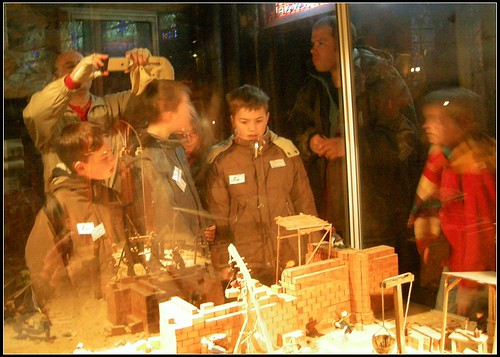 kids staring at the wooden model at Notre-Dame