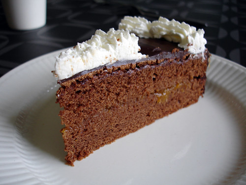 Chocolate pie with a layer of apricot and chocolate topping, finished with whipped cream