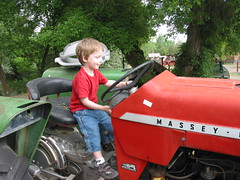Gavin loves riding tractors!