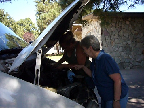 Mom helps fix the van.