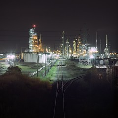 VT03 (peterbaker) Tags: night train dark mine glow power michigan detroit salt tracks oil refinery