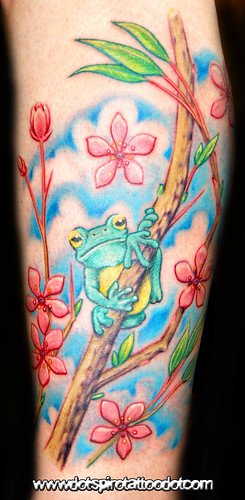 tree frog tattoo. Tree frog on a cherry blossom