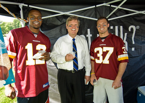 Secretary Vilsack and Redskins Reed Doughty and Malcolm Kelly don milk mustaches