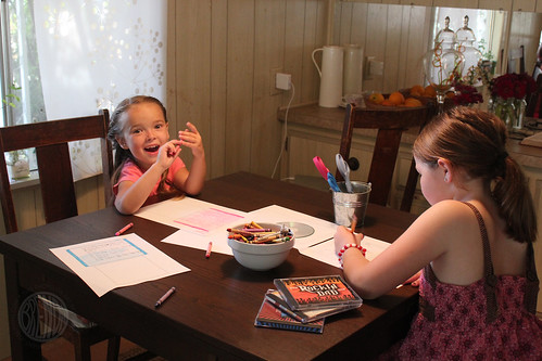 two girls coloring