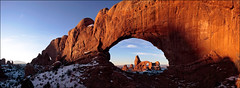 Turret Arch through North Window (Simon Christen - iseemooi) Tags: blue shadow red snow stone clouds contrast sunrise landscape delete2 utah sandstone arch save3 save7 save8 delete save save2 save9 save4 save5 save10 save6 archesnationalpark turretarch savedbythedeletemeuncensoredgroup