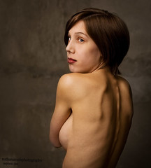 Back over shoulder (nathansmithphoto) Tags: portrait woman cold cute brick girl sarah hair concrete model eyes pretty breast edmonton skin cement lips piercing stairwell topless lipring cinderblock raisedeyebrow nathansmith