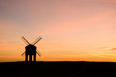 Chesterton Windmill (Winterspeak) Tags: uk pink winter light sunset england sky orange cloud sun color colour building brick english windmill silhouette yellow horizontal stone set clouds century landscape outside outdoors one 1 golden evening countryside skies arch britain dusk united country hill great sails salmon silhouettes kingdom arches grade structure gb sail restored 17 leamington colourful february pillars setting chesterton spa silhouetted warwickshire 17th listed failing seventeenth warks futilityhalloffame2009