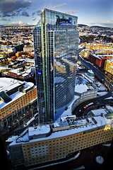 Oslo Plaza Hotel (trondjs) Tags: plaza city winter glass oslo norway architecture canon buildings reflections eos hotel mirror norge interestingness europe raw blu radisson hotelradisson mirrors sigma wideangle explore capitol covered highrise 5d nordic hotels np scandinavia 2009 modernarchitecture birdseyeview tallbuildings osloplaza eos5d hyblokk sigma2460 captiols interestingness62 i500 trondjs radissonsasplazahotel gallerioslo sigma2460mm sigma2460mm128exdg radissonbluplazahotel explore13mar2009 highrisehotel tengoodphotos1 sigma50th