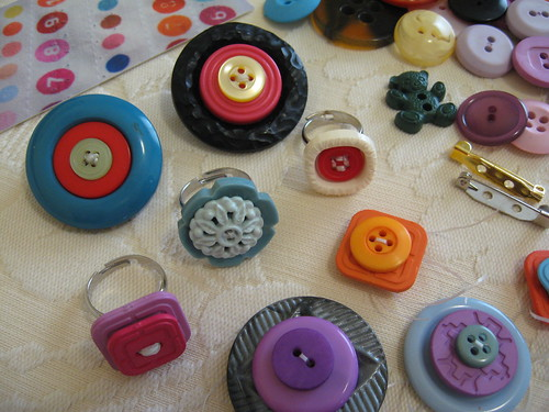 Button rings and brooches by you.