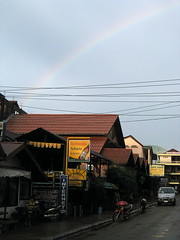 A rainbow over the restaurant and bar-filled streets of Vang Vieng