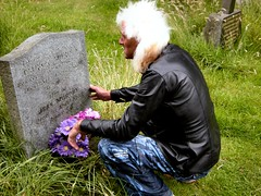 Fluffy kneeling at his parents grave (Mystic Ed & Fluffy) Tags: love grass dead reflecting parents sad cemetary prayer praying memories saints fluffy angels devotion gravestone catholicchurch blondehair crouching deceased remembering avemaria mothermary lifeanddeath supplication catholiccemetaries