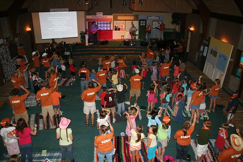 The kids and counselors alike enjoy the music during the close of our first day at Base Camp.