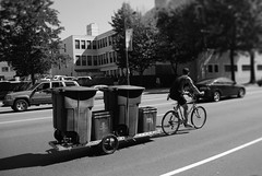 by bike all can be accomplished... (damonabnormal) Tags: street city people urban blackandwhite bw philadelphia bike bicycle candid streetphotography august pa tuesday recycle recycling phl 2009 215 desaturate workbike nocolor peopleinthecity bicyclecarrier workbicycle
