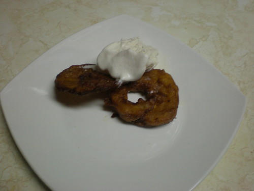 Two apple beignets with a scoop of vanilla ice cream