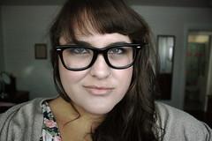 (Terin Talarico) Tags: selfportrait me self glasses dress hipster gap september greeneyes nosering brunette bangs 2009 cardigan 90s terin buddyhollyglasses