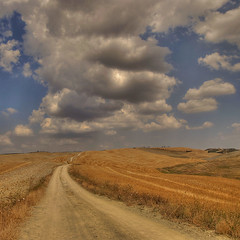 Summer in Tuscany (rinogas) Tags: italy beautiful clouds nikon nuvole estate tuscany siena d200 toscana hdr colline grano nikkor1224dx superaplus aplusphoto platinumheartaward flickraward rinogas flickrunitedaward trolledproud theadmirergroup