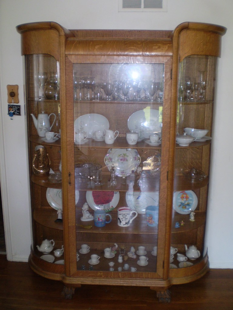 6 foot tall antique oak curved-glass china cabinet $1500
