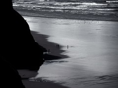 . (Tasmin_Bahia) Tags: sea people white holiday black beach water birds wales dark outside grey waves peace shadows peaceful cliffs ripples portenyon