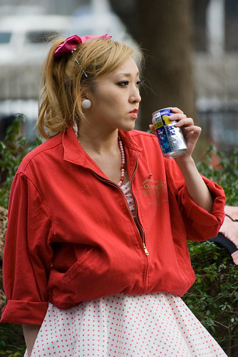 Girl drinking a can