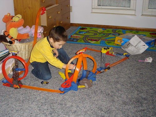 Mason playing with the car tracks