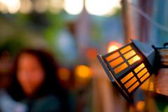 estherkeh (JKönig) Tags: light orange home evening backyard glow bokeh dusk depthoffield deck esther esther17 hbw twaslovely thiswasbeforewebuiltthefire sittingoutbackhangingout