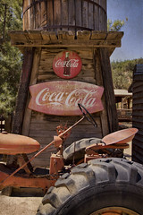 Break Time (Maureen Bond) Tags: ranch ca wood signs tractor vintage drink seat watertower wheels working pop tires explore textures soda cocacola thirsty steeringwheel cokebottles maureenbond