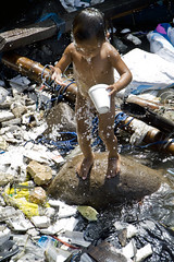 Ulingan, Tondo - The innovative and creative child of Ulingan (2/2) (Mio Cade) Tags: boy sea mountain water swim children boat kid garbage factory child philippines creative social dirty charcoal manila environment smoky issue hazardous adapt atrisk inhuman innovative tondo ulingan