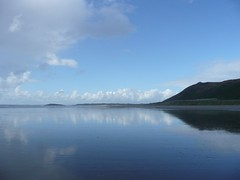 Reflected Hills. (Tasmin_Bahia) Tags: blue sea brown white black reflection green beach grass clouds sand peace stones smooth peaceful cliffs hills reflective whispy tasminbahia