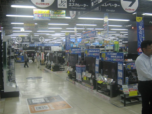 Maybe its just me, but I find Japanese electronics stores very intimidating. There are tons of products crammed into small spaces and lots of bright colors (usually red, but blue in this case) advertising things I cant read.