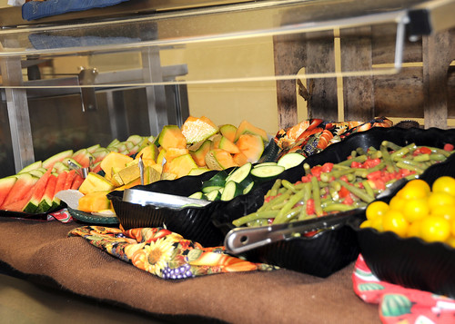 Locally grown fresh  vegetables and fruits are sliced and ready to students at Hebron-Harmon Elementary School in Hanover, MD.  The sign identifies the name of the local farm.